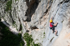 Jurica entering the crux of the route, a dyno from the small right hand crimp, with really bad feet. Photo: L. Tambača
