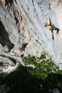 Perica grabing the crux crimp, 100m above the ground. Photo: L. Tambača